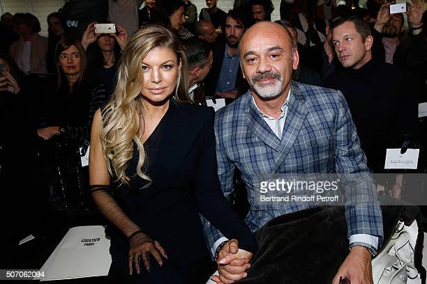 Singer Fergie and Christian Louboutin attend the Jean Paul Gaultier Spring Summer 2016 show as part of Paris Fashion Week on January 27 2016 in Paris...