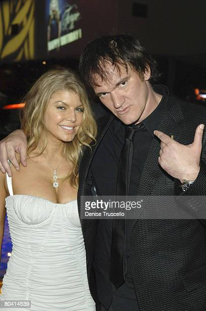 LAS VEGAS MARCH 27 Singer Fergie and director Quentin Tarantino at their birthday reception at Bare Pool Lounge at The Mirage Hotel and Casino Resort...