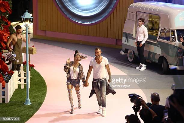 Singer Fergie and fashion Designer Philipp Plein acknowledge the applause of the audience at the Philipp Plein show during Milan Fashion Week...