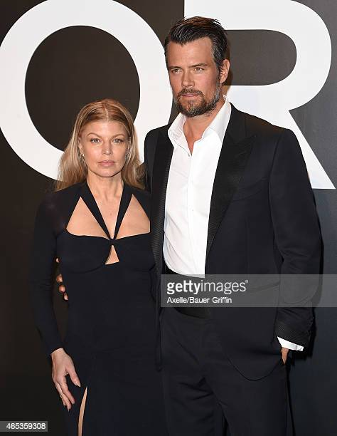 Singer Fergie and husband actor Josh Duhamel arrive at the Tom Ford Autumn/Winter 2015 Womenswear Collection Presentation at Milk Studios on February...