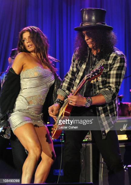 Singer Fergie and musician Slash onstage during the 52nd Annual GRAMMY Awards Salute To Icons Honoring Doug Morris held at The Beverly Hilton Hotel...