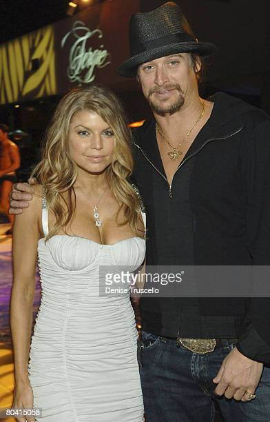 LAS VEGAS MARCH 27 Singer Fergie and singer Kid Rock at Fergie and Quentin Tarantino's birthday reception at Bare Pool Lounge at The Mirage Hotel and...