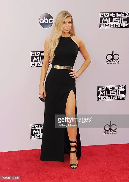 Singer Fergie arrives at the 2014 American Music Awards at Nokia Theatre LA Live on November 23 2014 in Los Angeles California