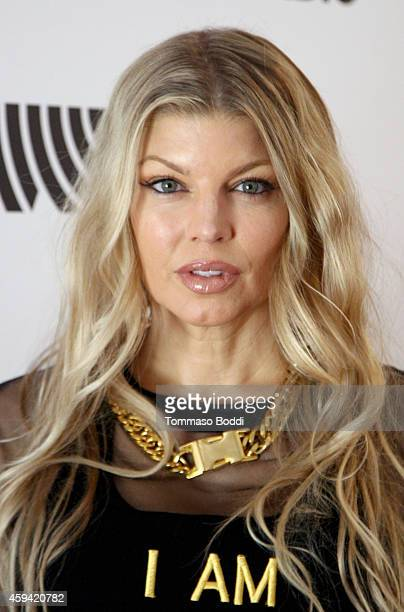 Singer Fergie attends Red Carpet Radio presented by Westwood One at Nokia Theatre LA Live on November 22 2014 in Los Angeles California