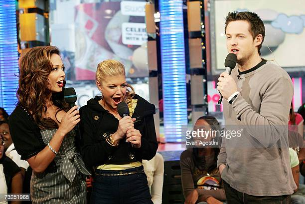 Singer Fergie chats with VJ's Vanessa Minnillo and Damien Fahey during an appearance on MTV's Total Request Live February 07 2007 in New York City