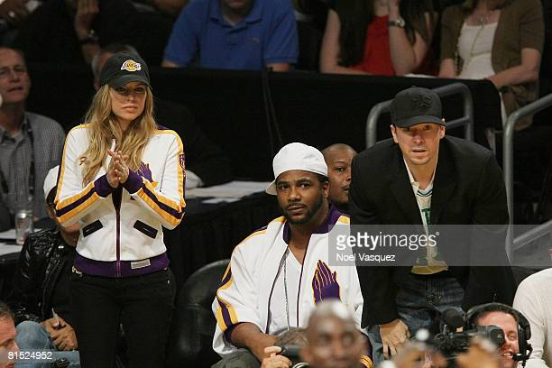 Singer Fergie guest and singer Donnie Wahlberg attend Game Three of the 2008 NBA Finals between the Boston Celtics and the Los Angeles Lakers on June...