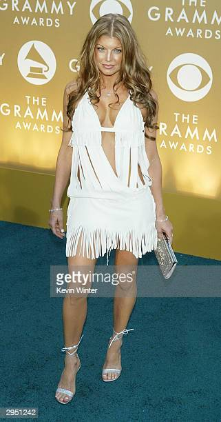 Singer Fergie of Black Eyed Peas arrives at the 46th Annual Grammy Awards held at the Staples Center on February 8 2004 in Los Angeles California