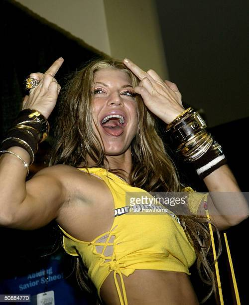 Singer Fergie of the Black Eyed Peas makes her exit from the pressroom at Madison Square Garden during the Z100 Zootopia 2004 concert in New York May...