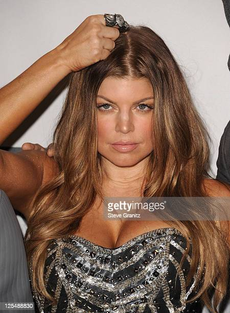 Singer Fergie of the Black Eyed Peas poses in the press room during the 2010 American Music Awards held at Nokia Theatre L.A. Live on November 21,...