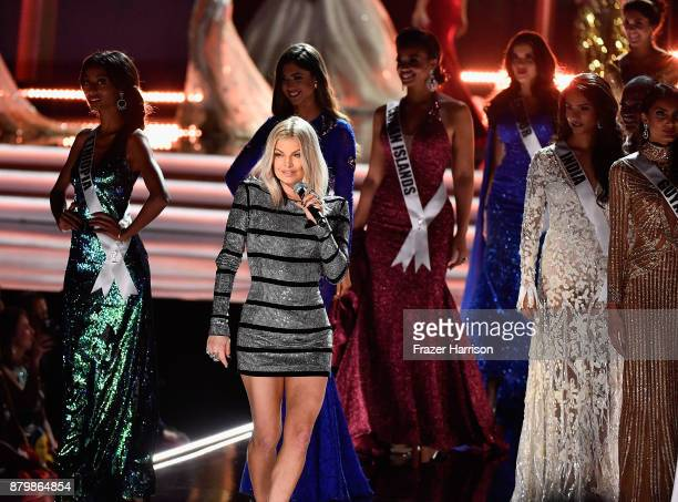 Singer Fergie performs as contestants walk the stage during the 2017 Miss Universe Pageant at The Axis at Planet Hollywood Resort Casino on November...