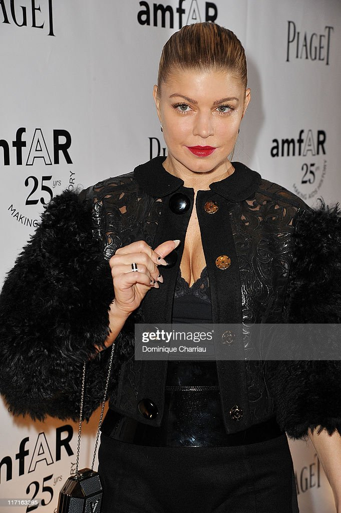 Singer Fergie poses as she arrives at the 25th amfAR Inspiration Gala at Pavillon Gabriel on June 23, 2011 in Paris, France.
