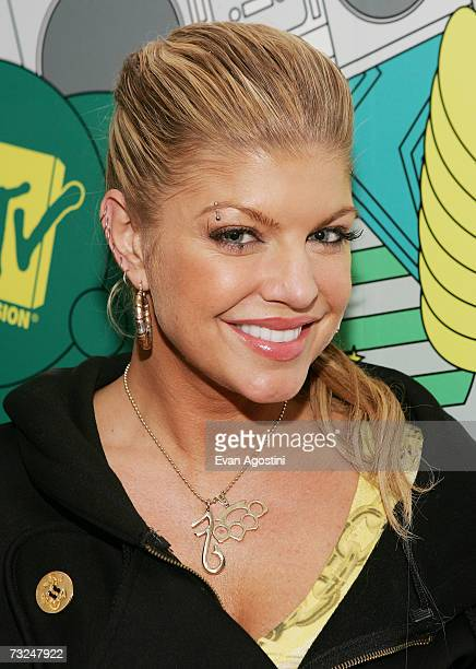 Singer Fergie poses backstage after her appearance on MTV's Total Request Live February 07 2007 in New York City