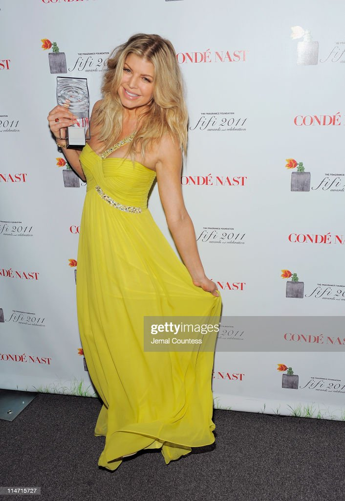 Singer Fergie poses backstage at the 2011 FiFi Awards at The Tent at Lincoln Center on May 25, 2011 in New York City.