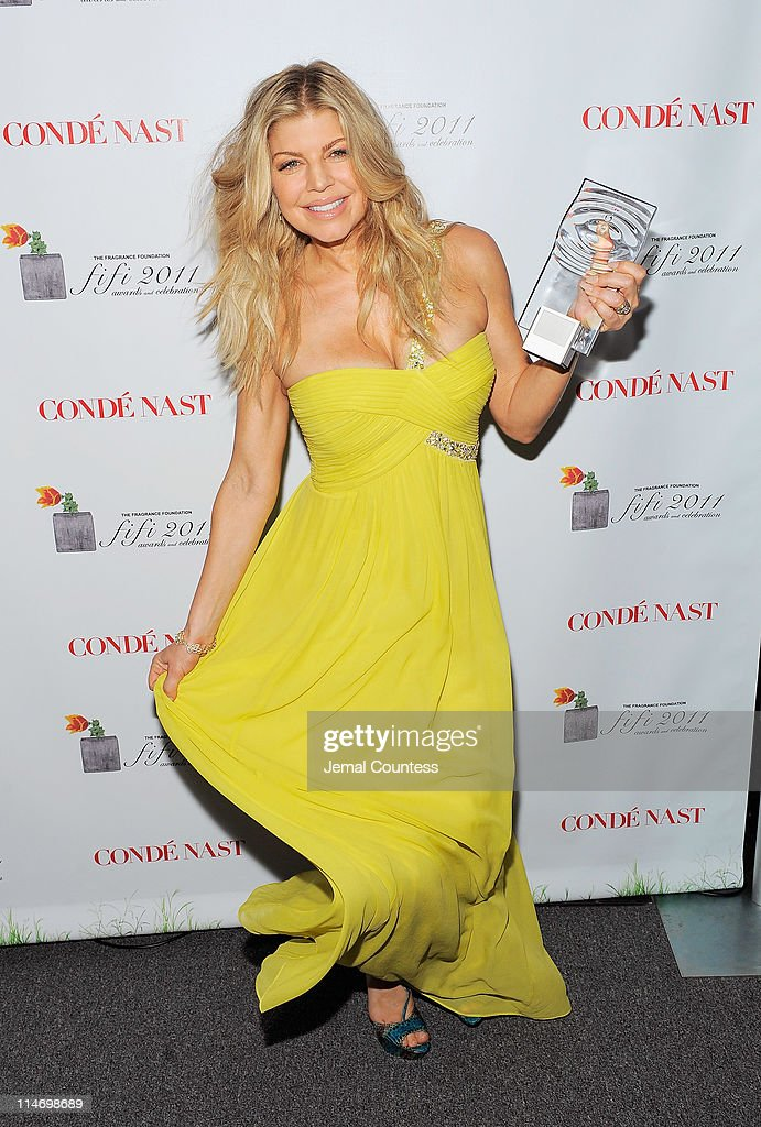 Singer Fergie poses with FiFi New Celebrity Fragrance of the Year Award backstage at the 2011 FiFi Awards at The Tent at Lincoln Center on May 25, 2011 in New York City.