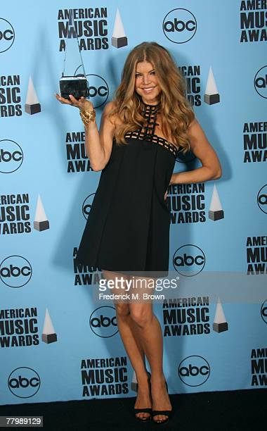 Singer Fergie poses with her award for Favorite Female Pop Rock Artist in the press room at the 2007 American Music Awards held at the Nokia Theatre...