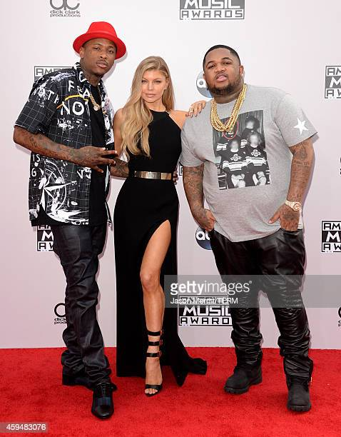 Singer Fergie with YG and DJ Mustard attend the 2014 American Music Awards at Nokia Theatre LA Live on November 23 2014 in Los Angeles California