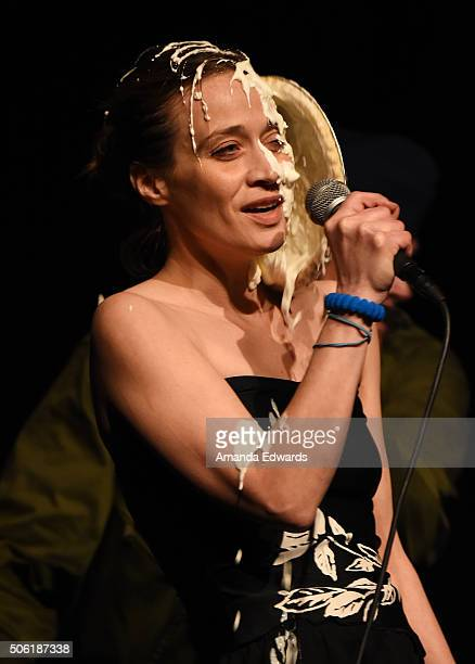 Singer Fiona Apple has a pie thrown at her by director Mark Romanek while performing onstage at the Film Independent Live Read of Dr Strangelove with...