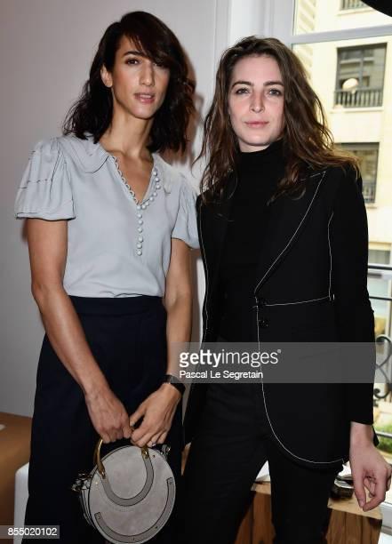 Singer Fiora and Deniz Gamze Erguven attend the Chloe show as part of the Paris Fashion Week Womenswear Spring/Summer 2018 on September 28 2017 in...