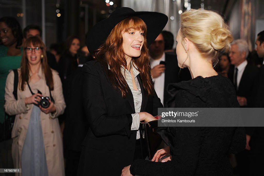 Singer Florence Welch and actress Carey Mulligan, both wearing Prada, attend Catherine Martin And Miuccia Prada Dress Gatsby Opening Cocktail on April 30, 2013 in New York City.