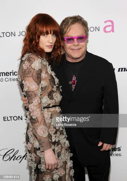 Singer Florence Welch and musician Elton John arrive at the 19th Annual Elton John AIDS Foundation Academy Awards Viewing Party at the Pacific Design...