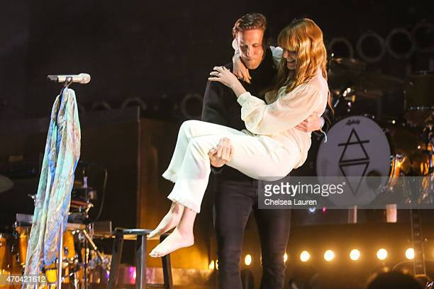 Singer Florence Welch of Florence The Machine is carried onto stage after breaking her foot during her weekend 1 performance at Coachella Valley...