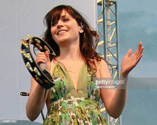 Singer for the group She Him/actress Zooey Deschanel performs on stage at the Los Angeles Times Celebration of Food Wine at Paramount Studios on...