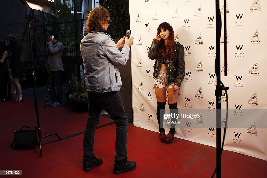 Singer Foxes being photographed by Mick Rock at W Hollywood Kicks Off IMS Engage With Symmetry at W Hollywood on April 16, 2013 in Hollywood, California.