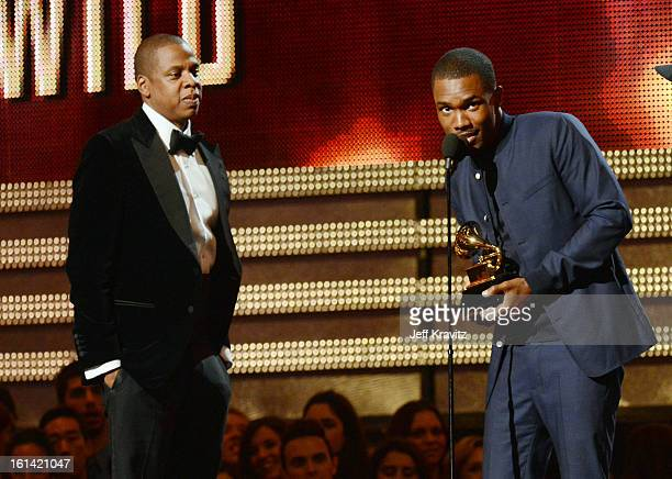 Singer Frank Ocean accepts an award as rapper JayZ looks on onstage at the 55th Annual GRAMMY Awards at Staples Center on February 10 2013 in Los...