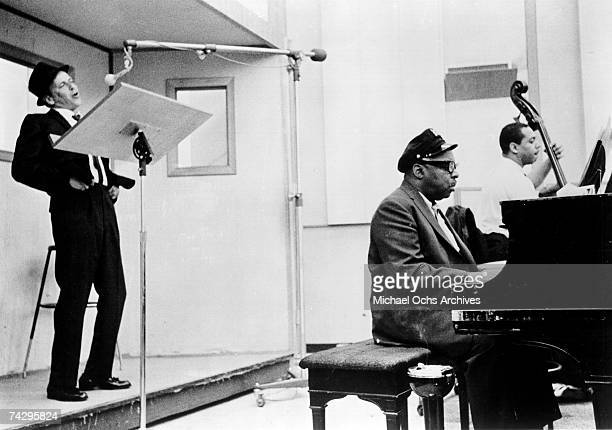 Singer Frank Sinatra and bandleader Count Basie record in the studio on October 2 1963