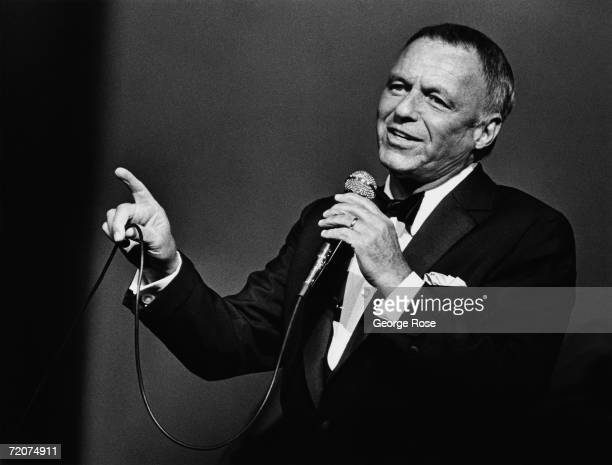 Singer Frank Sinatra belts out a song during a 1980 Universal City, California, performance at the Universal Amphitheatre.