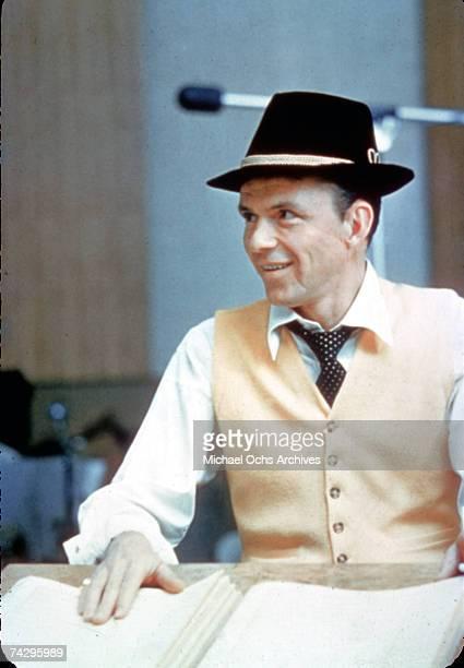 Singer Frank Sinatra wears a hat as he records in the studio in 1962