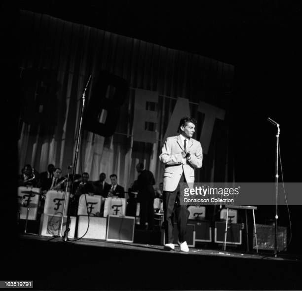 Singer Frankie Avalon performs onstage during Alan Freed's 4th anniversary rock and roll show The Big Beat at the Brooklyn Fox Theater on August 29...