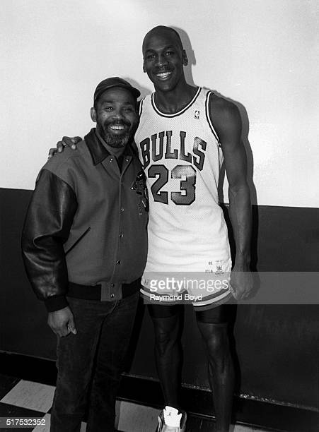Singer Frankie Beverly from Maze featuring Frankie Beverly poses for photos with former Chicago Bulls basketball player Michael Jordan after a Bulls...