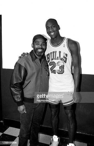 Singer Frankie Beverly of Maze featuring Frankie Beverly poses for photos with Chicago Bulls basketball player Michael Jordan after the Bulls' game....