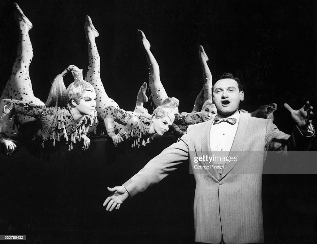 Singer Frankie Laine entertains in Las Vegas with showgirls. Scene from MGM's Las Vegas. BPA2# 3783