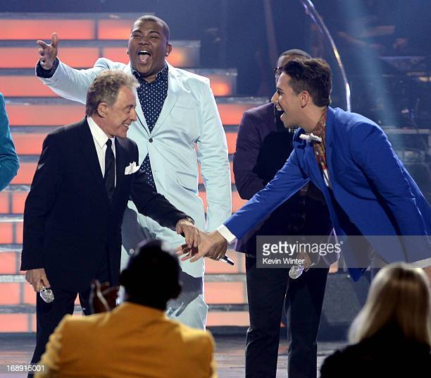 Singer Frankie Valli contestants Curtis Finch Jr Burnell Taylor and Lazaro Arbos perform onstage during Fox's 'American Idol 2013' Finale Results...