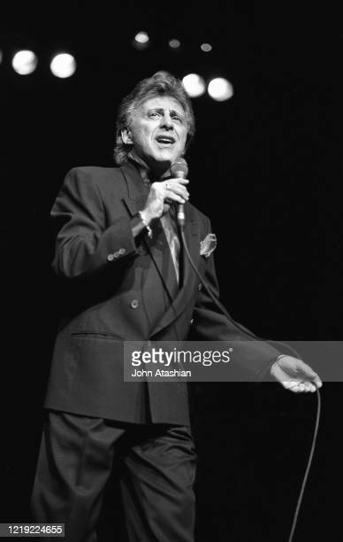 Singer Frankie Valli former frontman of The Four Seasons is shown performing on stage during a live concert appearance on December 1 1999
