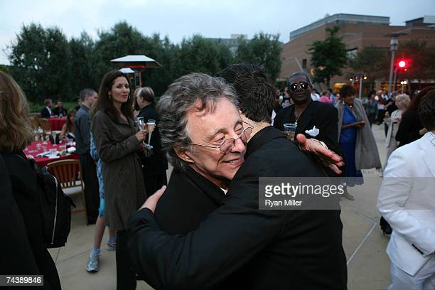 Singer Frankie Valli hugs Castmember Actor Christopher Kale Jones during the opening night party for 'Jersey Boys' the 2006 Tony Award winner for...