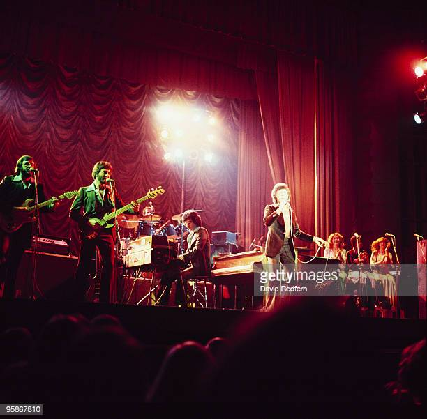 Singer Frankie Valli performs on stage with the Four Seasons in the 1970's