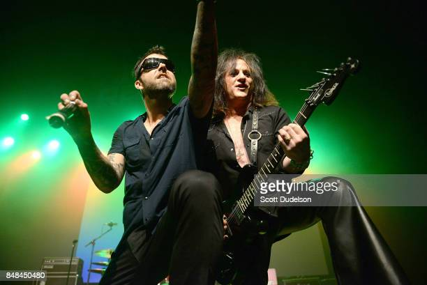 Singer Franky Perez and guitarist Steve Stevens of the Billy Idol band perform onstage during the second annual Rock for Recovery benefit concert at...