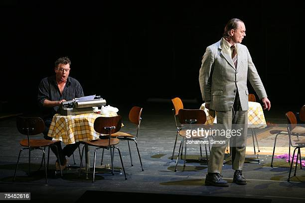Singer Franz Hawlata playing the part of Hans Sachs and Michael Volle playing the part of Sixtus Beckmesser perform on stage during the rehearsal of...