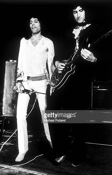 Singer Freddie Mercury and guitarist Brian May of British rock band Queen performing on stage in London on 8th July 1973