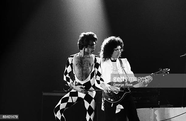 Singer Freddie Mercury and guitarist Brian May of the rock group Queen perform We Are The Champions onstage during a 1978 Inglewood California...