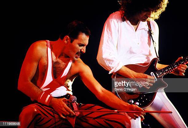 Singer Freddie Mercury and guitarist Brian May performing with British rock group Queen Brussels 1984