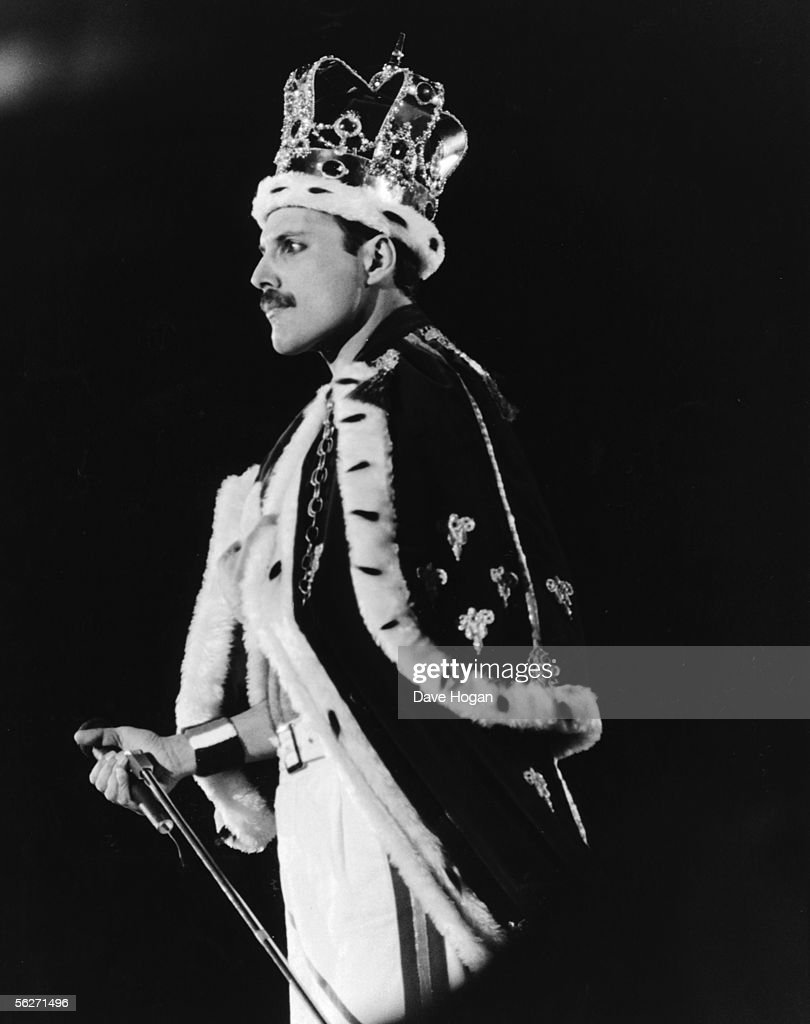 Singer Freddie Mercury dressed as a King during a performance with his group Queen at Wembley Stadium in London, 15th July 1986.
