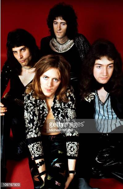 Singer Freddie Mercury drummer Roger Taylor guitarist Brian May and bassist John Deacon of British rock band Queen pose in London England in 1973