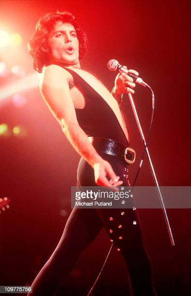 Singer Freddie Mercury of British rock band Queen performing on stage in 1975