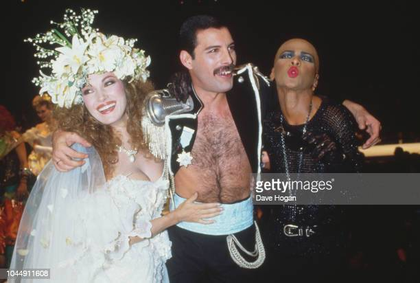 Singer Freddie Mercury of British rock group Queen, with English actress Jane Seymour during the Fashion Aid benefit concert for Ethiopian famine...