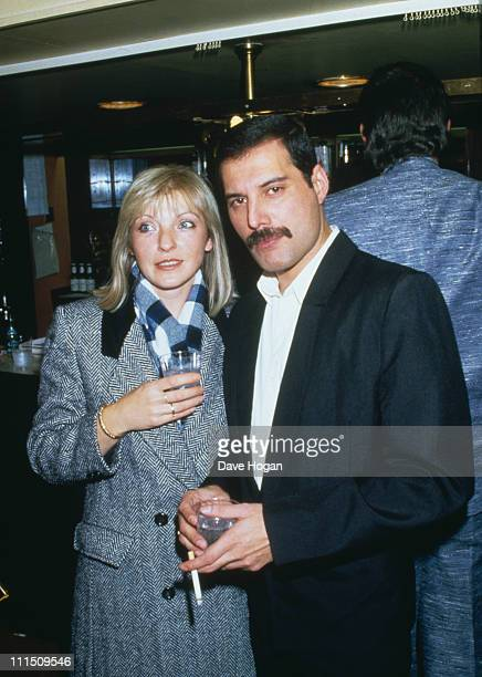 Singer Freddie Mercury of Queen attends Fashion Aid at the Royal Albert Hall in London with his friend Mary Austin 5th November 1985