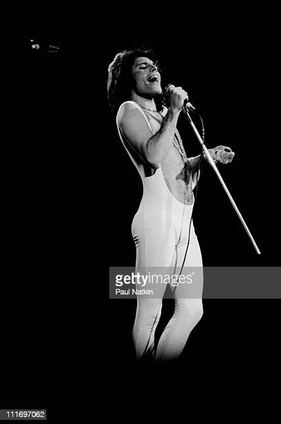 Singer Freddie Mercury of Queen performs at the Chicago Stadium on January 28 1977 in Chicago Illinois